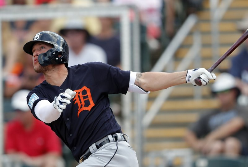 Detroit Tigers left fielder JaCoby Jones (21) follows through on a two-run home run in the fifth inning of a spring training baseball game against the Minnesota Twins Monday, March 11, 2019, in Fort Myers, Fla. (AP Photo/John Bazemore)