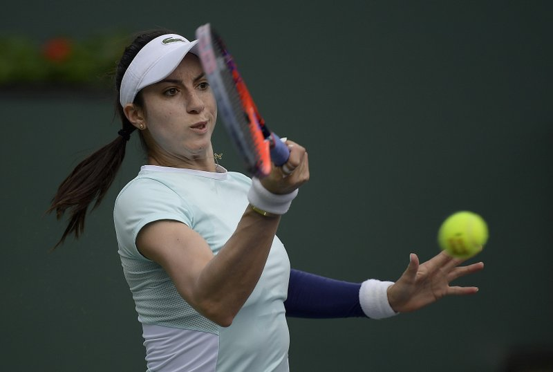 Christina McHale returns a shot to Venus Williams at the BNP Paribas Open tennis tournament Monday, March 11, 2019, in Indian Wells, Calif. (AP Photo/Mark J. Terrill)