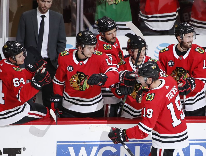 Chicago Blackhawks center Jonathan Toews (19) celebrates with teammates after his penalty goal against the Arizona Coyotes during the second period of an NHL hockey game Monday, March 11, 2019, in Chicago. (AP Photo/Kamil Krzaczynski)