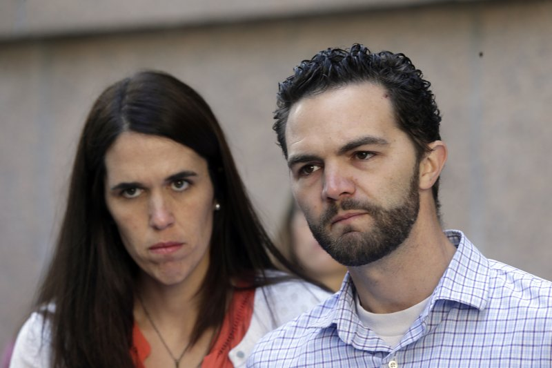 FILE - This March 31, 2016, file photo shows Rusty and Summer Page, foster parents of Lexi, a then-6-year-old girl with Native American ancestry, who was removed from their home, outside the California Court of Appeal in downtown Los Angeles. (AP Photo/Nick Ut, File)