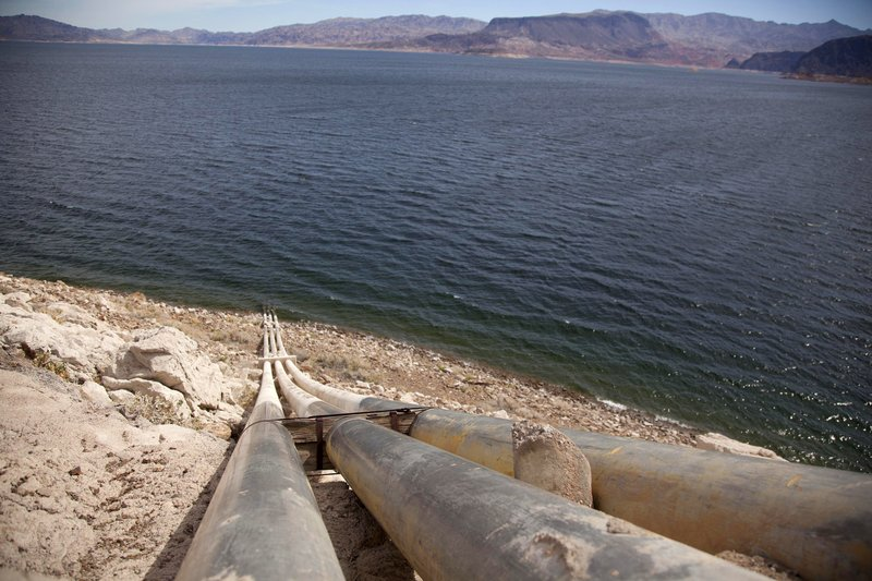 FILE - This March 23, 2012, file photo shows pipes extending into Lake Mead well above the high water mark near Boulder City, Nevada. (AP Photo/Julie Jacobson, File)