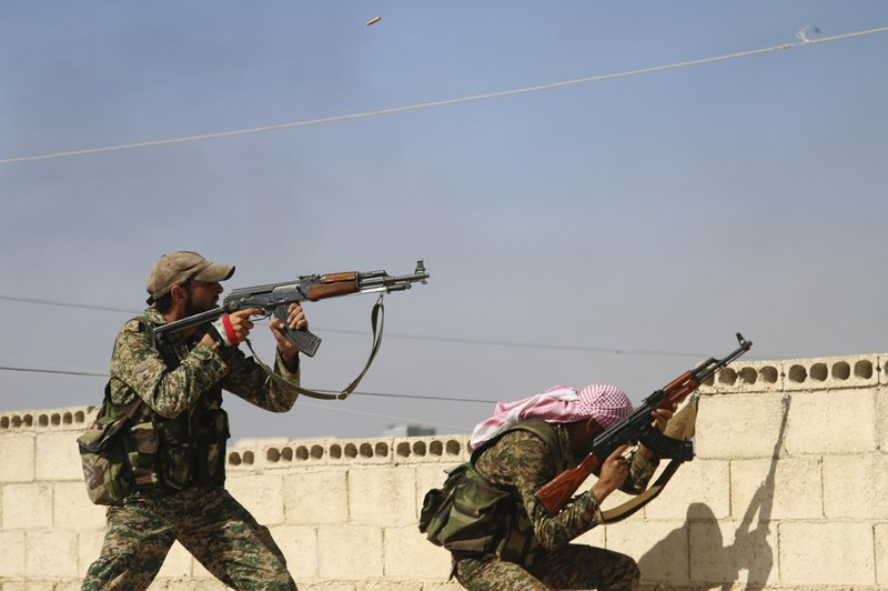 In this Oct. 11, 2015 file photo, Syrian soldiers fire repelling an attack in Achan, Hama province, Syria. (Alexander Kots/Komsomolskaya Pravda via AP, File)