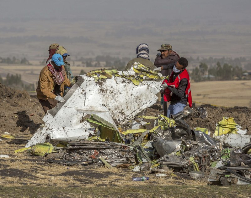 Rescuers work at the scene of an Ethiopian Airlines flight crash near Bishoftu, or Debre Zeit, south of Addis Ababa,  Ethiopia, Monday, March 11, 2019. (AP Photo/Mulugeta Ayene)