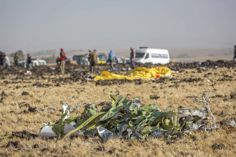 Parts of the plane wreckage with rescue workers at the crash site at Bishoftu, or Debre Zeit, outside Addis Ababa, Ethiopia, Monday, March 11, 2019, where Ethiopia Airlines Flight 302 crashed Sunday. (AP Photo/Mulugeta Ayene)