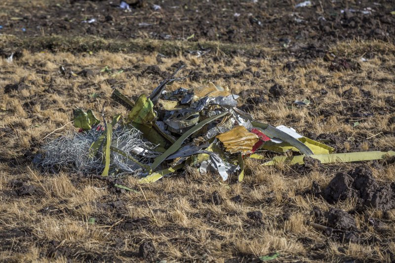 A pile of debris on the ground at Bishoftu, or Debre Zeit, outside Addis Ababa, Ethiopia, Monday, March 11, 2019, where Ethiopia Airlines Flight 302 crashed Sunday. (AP Photo/Mulugeta Ayene)