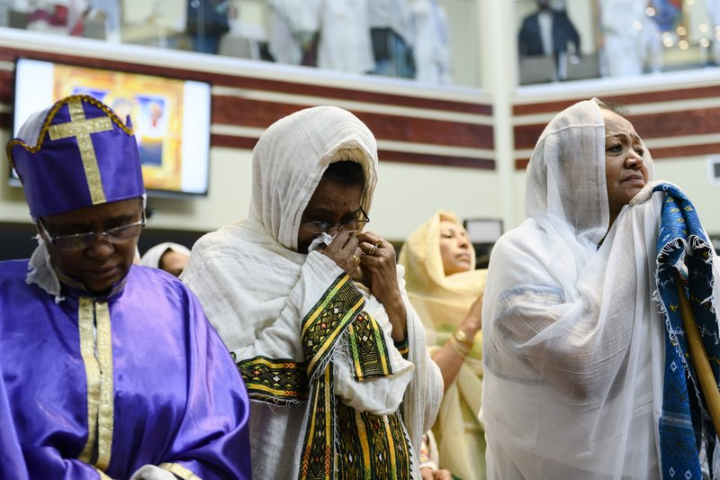 Members of the Ethiopian community take part in a special prayer for the victims of the Ethiopian Airlines flight ET302 crash, at the Ethiopian Orthodox Tewahedo Church of Canada Saint Mary Cathedral in Toronto, on Sunday, March 10, 2019. (Christopher Katsarov/The Canadian Press via AP)