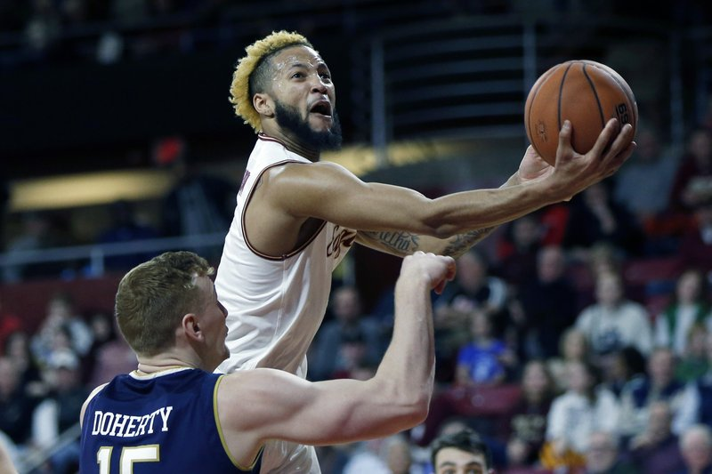 FILE - In this Feb. 2, 2019, file photo, Boston College's Ky Bowman shoots over Notre Dame's Chris Doherty (15) during the first half of an NCAA college basketball game, in Boston. (AP Photo/Michael Dwyer, File)