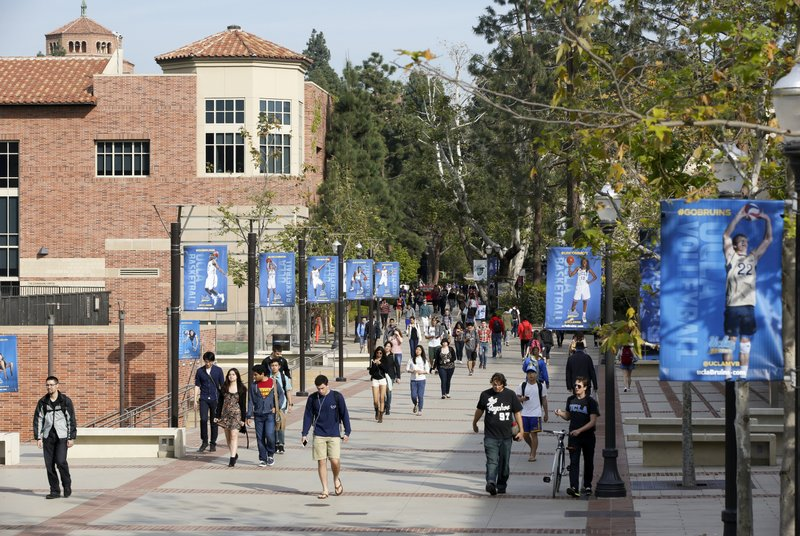 FILE - In this Feb. 26, 2015, file photo, students walk on the University of California, Los Angeles campus. (AP Photo/Damian Dovarganes, File)