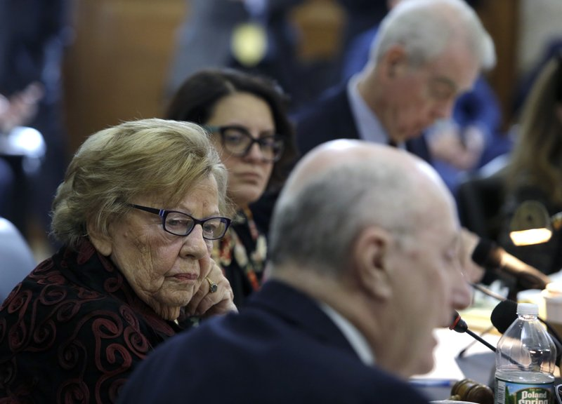 New Jersey state Sen. Loretta Weinberg, left, listens to special counsel Michael Critchley, Sr. ask Albert Alvarez questions before the joint legislative oversight committee, Tuesday March 12, 2019 in Trenton, NJ. (AP Photo/Jacqueline Larma)