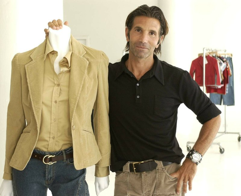 FILE - This May 15, 2002 file photo shows Los-Angeles based clothing designer Mossimo Giannulli posing with his fall preview clothing for Target department stores in New York. (AP Photo/Kathy Willens, File)