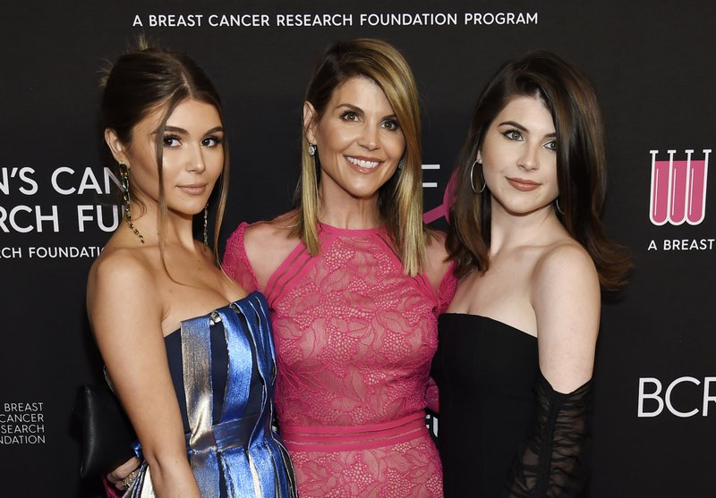 FILE - In this Feb. 28, 2019 file photo, actress Lori Loughlin, center, poses with daughters Olivia Jade Giannulli, left, and Isabella Rose Giannulli at the 2019