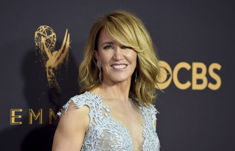 FILE - This Sept. 17, 2017 file photo shows actress Felicity Huffman at the 69th Primetime Emmy Awards in Los Angeles. (Photo by Jordan Strauss/Invision/AP, File)