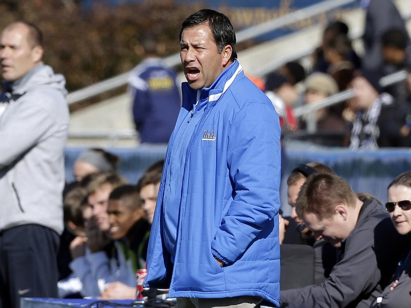 FILE - In this Dec. 14, 2014 file photo, UCLA coach Jorge Salcedo reacts during the first half of an NCAA College Cup championship soccer game against Virginia in Cary, N. (AP Photo/Gerry Broome, File)
