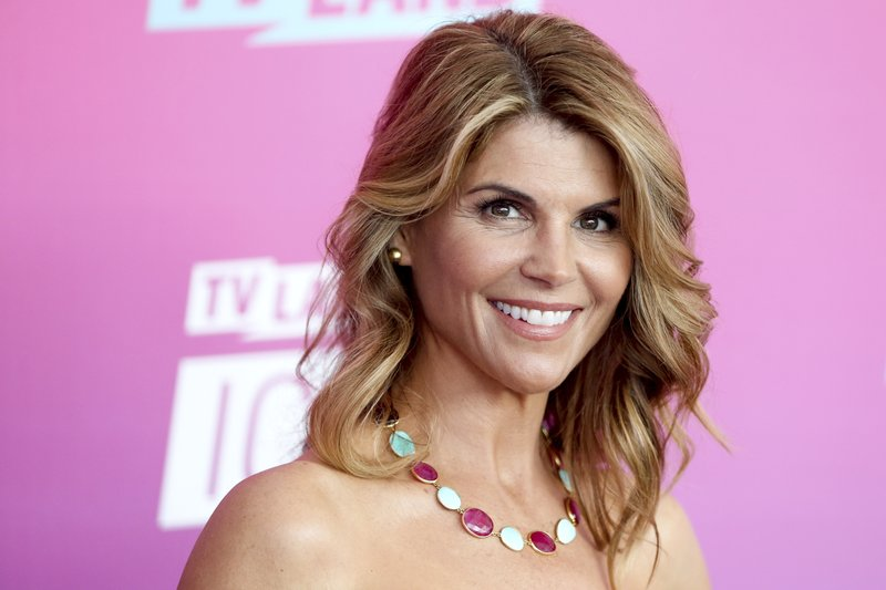 FILE - In this April 10, 2016 file photo, actress Lori Loughlin arrives at the TV Land Icon Awards in Santa Monica, Calif. (Photo by Rich Fury/Invision/AP, File)