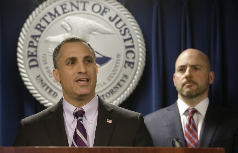 FBI Special Agent in Charge Boston Division Joseph Bonavolonta, left, and U.S. Attorney for District of Massachusetts Andrew Lelling, right, face reporters as they announce indictments in a sweeping college admissions bribery scandal during a news conference, Tuesday, March 12, 2019, in Boston. (AP Photo/Steven Senne)