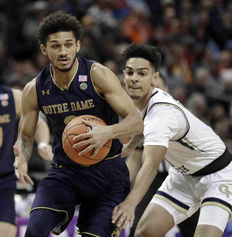 Notre Dame's Prentiss Hubb, left, drives past Georgia Tech's Jose Alvarado, right, during the first half of an NCAA college basketball game in the Atlantic Coast Conference tournament in Charlotte, N. (AP Photo/Nell Redmond)