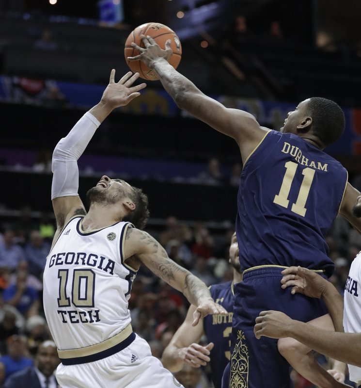 Notre Dame's Juwan Durham (11) blocks a shot by Georgia Tech's Jose Alvarado (10) during the first half of an NCAA college basketball game in the Atlantic Coast Conference tournament in Charlotte, N. (AP Photo/Nell Redmond)