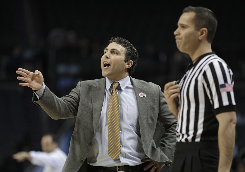 Georgia Tech head coach Josh Pastner, left, directs his team against Notre Dame during the first half of an NCAA college basketball game in the Atlantic Coast Conference tournament in Charlotte, N. (AP Photo/Nell Redmond)