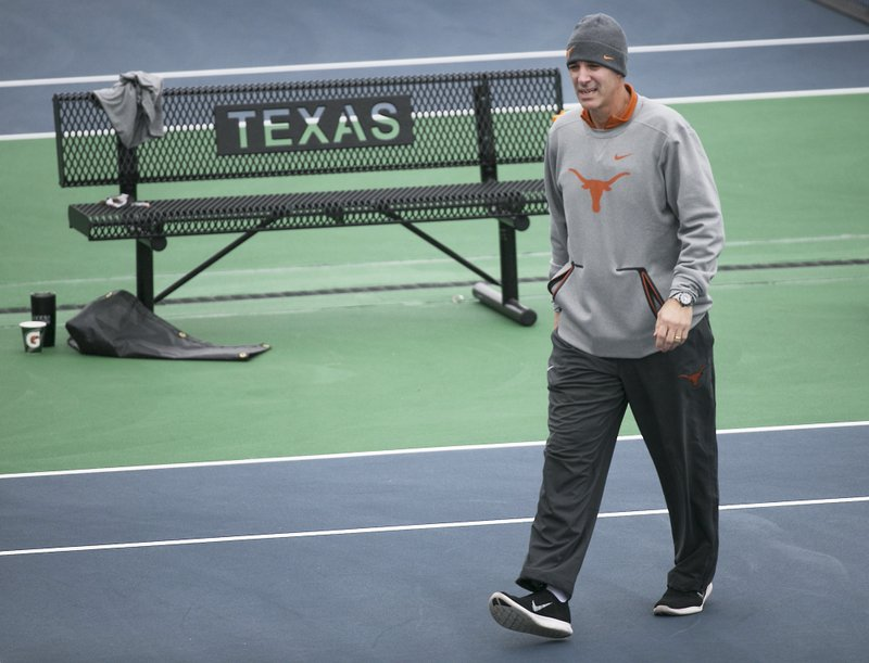 In this January 2018 photo, Texas men's tennis coach Michael Center surveys the courts before the matches with UTSA, in Austin, Texas. (Ralph Barrera/Austin American-Statesman via AP)
