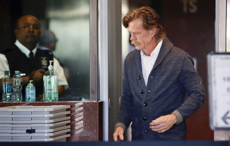 Actor William H. Macy arrives at the federal courthouse in Los Angeles, on Tuesday, March 12, 2019.  Fifty people, including Macy's wife, actress Felicity Huffman and actress Lori Loughlin, were charged Tuesday in a scheme in which wealthy parents allegedly bribed college coaches and other insiders to get their children into some of the nation's most elite schools. (AP Photo/Alex Gallardo)