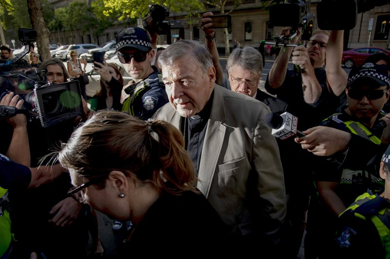 FILE - In this Feb. 27, 2019, file photo, Cardinal George Pell, center, arrives at the County Court in Melbourne, Australia. (AP Photo/Andy Brownbill, File)
