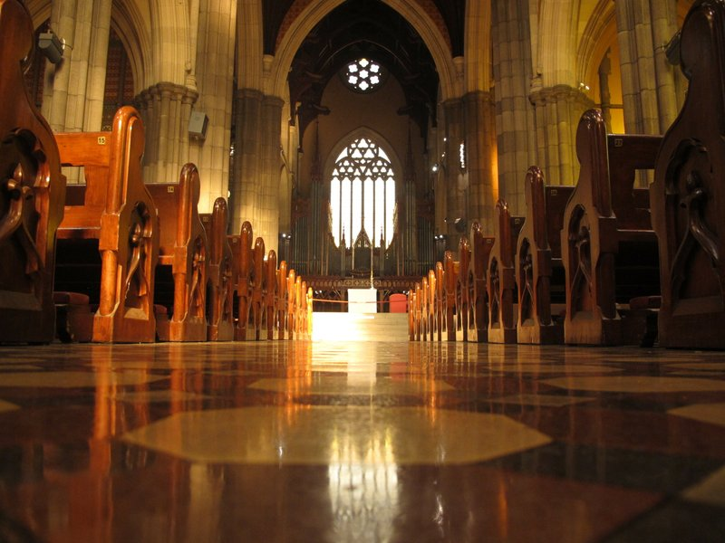 In this Sunday, Sept. 9, 2018, photo, pews line the shiny isle inside the St. Patrick's Cathedral in Melbourne. (AP Photo/Rod McGuirk)