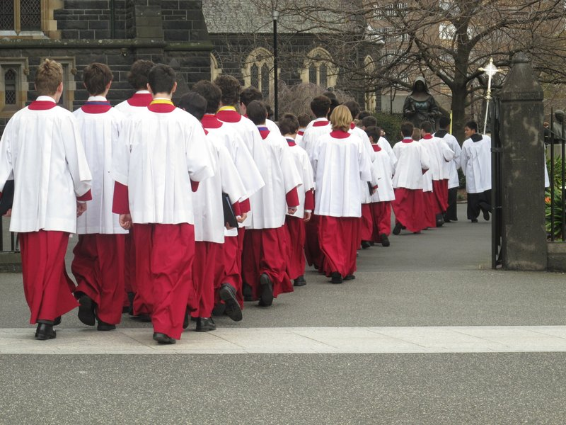 In this Sunday Sept. 9, 2018, choir boys leave after mass at the St. Patrick's Cathedral in Melbourne. (AP Photo/Rod McGuirk)