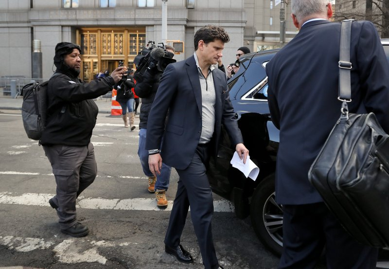 Gordon Caplan of Greenwich, Conn., center, walks out of federal court Tuesday, March 12, 2019, in New York. (AP Photo/Julie Jacobson)