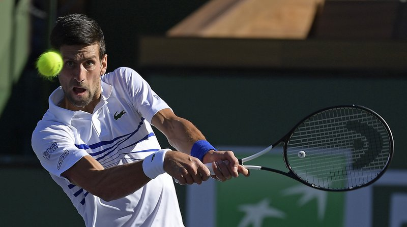 Novak Djokovic, of Serbia, returns a shot to Philipp Kohlschreiber at the BNP Paribas Open tennis tournament Tuesday, March 12, 2019 in Indian Wells, Calif. (AP Photo/Mark J. Terrill)