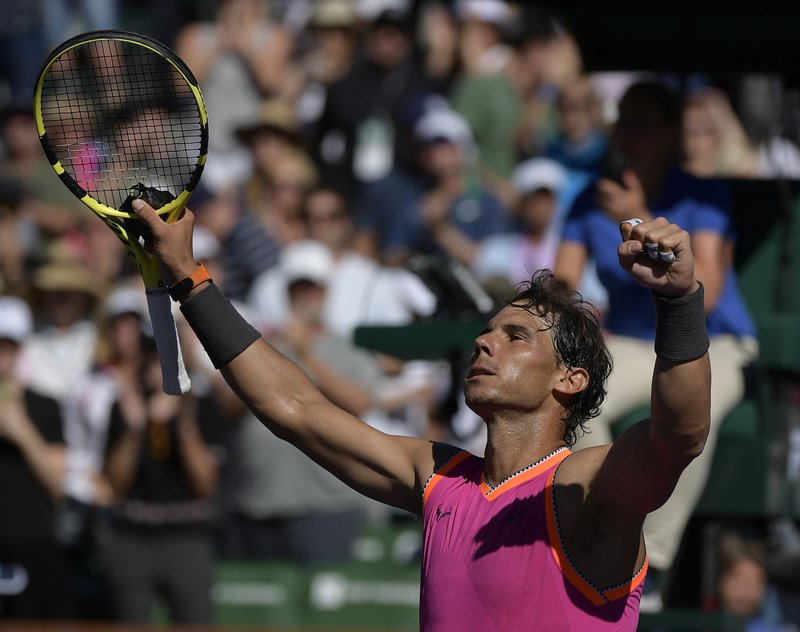 Rafael Nadal, of Spain, celebrates after defeating Diego Schwartzman, of Argentina at the BNP Paribas Open tennis tournament Tuesday, March 12, 2019 in Indian Wells, Calif. (AP Photo/Mark J. Terrill)