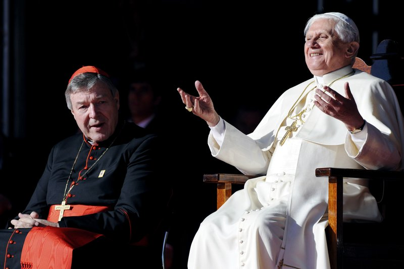 FILE - In this July 21, 2008, file photo, then Pope Benedict XVI, right, gestures as he sits with Cardinal George Pell during a ceremony to thank World Youth Day volunteers in Sydney. (Dean Lewins/Pool Photo via AP, File)