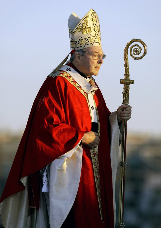 FILE - In this July 15, 2008, file photo, Cardinal George Pell walks onto the stage for the opening mass for World Youth Day in Sydney. (AP Photo/Rick Rycroft, File)