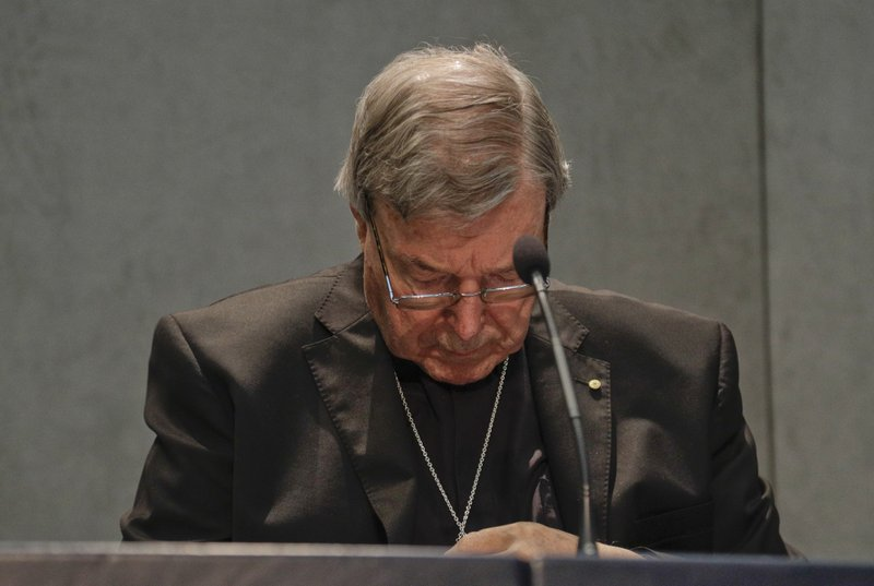 FILE - In this June 29, 2017, file photo, Cardinal George Pell meets the media at the Vatican. Pell was sentenced in an Australian court on Wednesday, March 13, 2019 to 6 years in prison for molesting two choirboys in a Melbourne cathedral more than 20 years ago. (AP Photo/Gregorio Borgia, File)