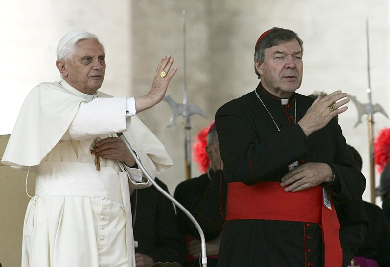 FILE - In this Oct. 12, 2005, file photo, then Pope Benedict XVI, left, and Cardinal George Pell bless the faithful during the weekly general audience in St. (AP Photo/Gregorio Borgia, File)