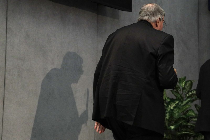 FILE - In this June 29, 2017, file photo, Cardinal George Pell leaves after meeting the media at the Vatican. (AP Photo/Gregorio Borgia, File)