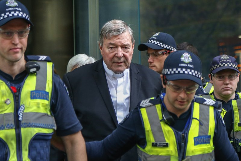FILE - In this May 2, 2018, file photo, Cardinal George Pell, the most senior Catholic cleric to face sex charges, leaves court in Melbourne, Australia. (AP Photo/Asanka Brendon Ratnayake, File)