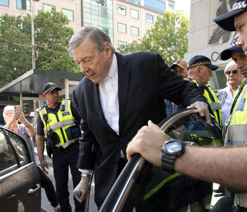 In this Dec. 11, 2018, photo, Cardinal George Pell leaves the County Court in Melbourne, Australia, after his conviction. (AP Photo/Andy Brownbill)