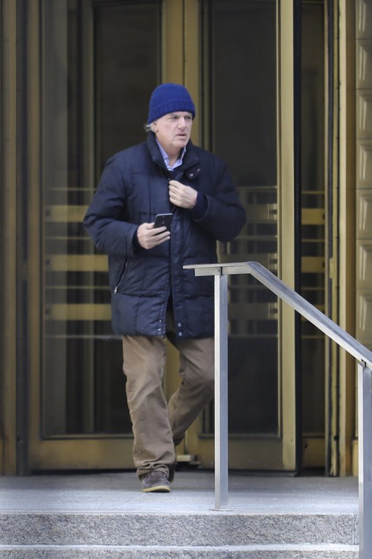 Gregory Abbott, founder and chairman of International Dispensing Corporation, leaves after appearing in federal court in New York on bribery charges, Tuesday, March 12, 2019. (AP Photo/Bebeto Matthews)