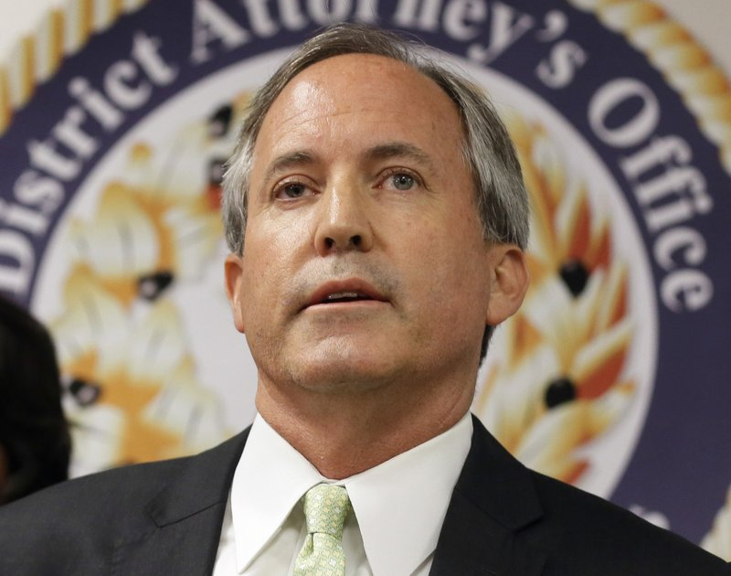 FILE - In this June 22, 2017, file photo, Texas Attorney General Ken Paxton speaks at a news conference in Dallas. (AP Photo/Tony Gutierrez, File)