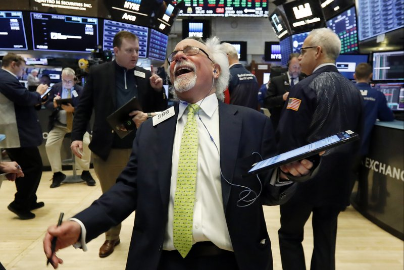 Trader Peter Tuchman laughs as he works on the floor of the New York Stock Exchange, Wednesday, March 13, 2019. (AP Photo/Richard Drew)