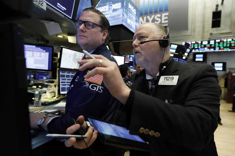 Specialist Gregg Maloney, left, and trader Robert Moran work on the floor of the New York Stock Exchange, Wednesday, March 13, 2019. (AP Photo/Richard Drew)