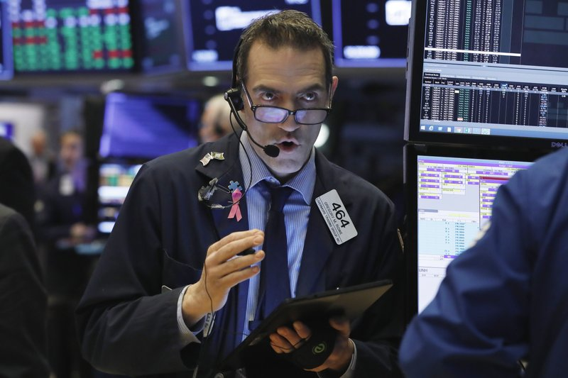 Gregory Rowe works on the floor of the New York Stock Exchange, Wednesday, March 13, 2019. U.S. stocks opened broadly higher on Wall Street Wednesday, powered by technology and health care companies, as the market pushes for its third straight day of gains. (AP Photo/Richard Drew)