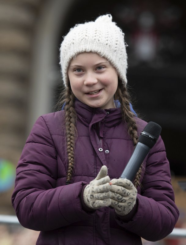 Swedish climate activist Greta Thunberg holds a microphone as she attends a protest rally in Hamburg, Germany, Friday, March 1, 2019. (Daniel Reinhardt/dpa via AP)
