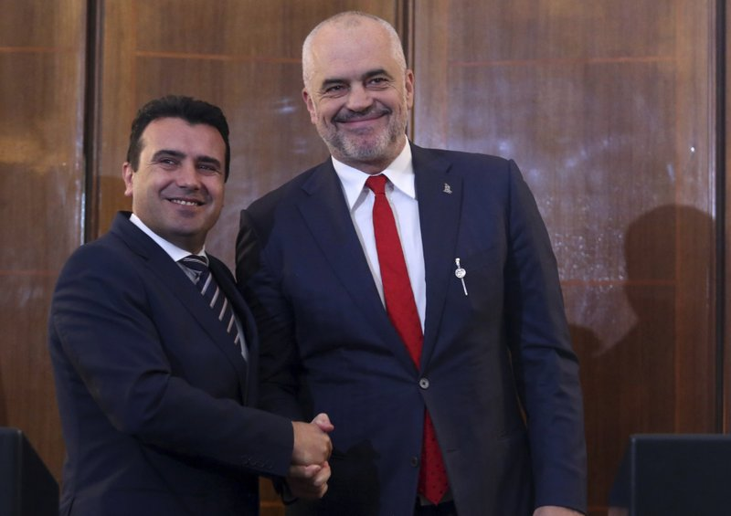 North Macedonia's Prime Minister Zoran Zaev, left, and his Albanian counterpart Edi Rama shake hands during their meeting in Tirana, Wednesday, March 13, 2019. (AP Photo)