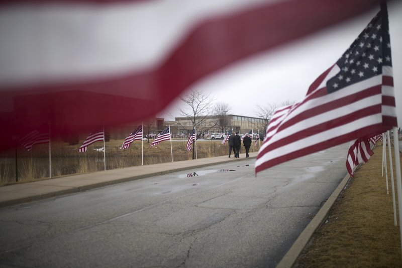 Law enforcement departments from all over the area arrive before funeral services for slain McHenry County Sheriff's Deputy Jacob Keltner on Wednesday, March 13, 2019, at Woodstock North High School in Woodstock, Ill. (Scott P. Yates/Rockford Register Star via AP)