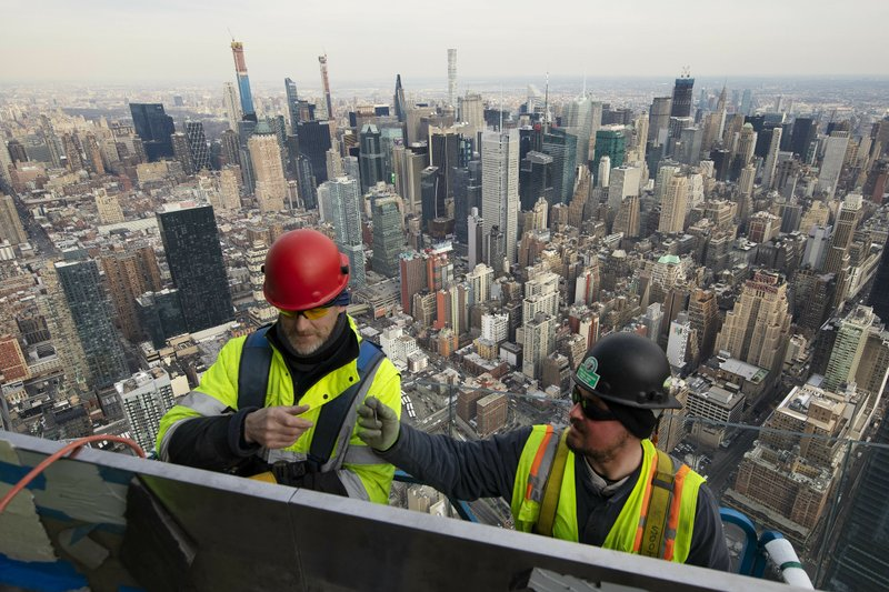 In this March 8, 2019 photo, work continues on an outdoor observation deck on the 30 Hudson Yards office building in New York. (AP Photo/Mark Lennihan)