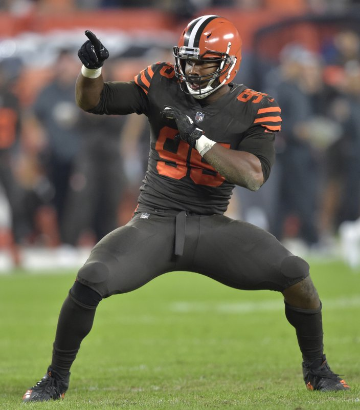 FILE - In this Sept. 20, 2018, file photo, Cleveland Browns defensive end Myles Garrett (95) celebrates a sack during an NFL football game against the New York Jets, in Cleveland. (AP Photo/David Richard, File)