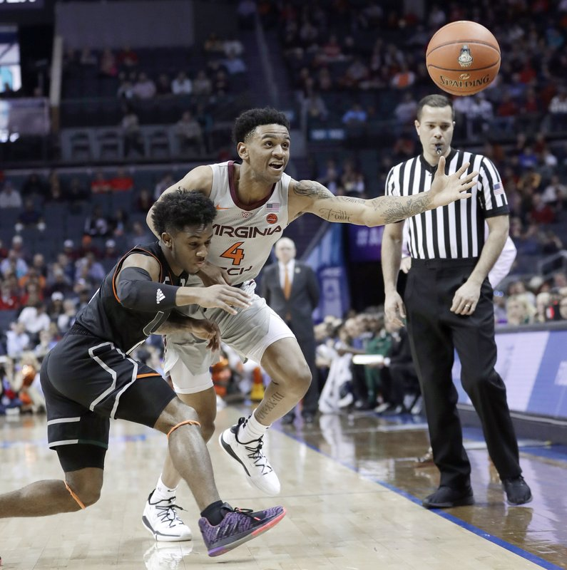 Virginia Tech's Nickeil Alexander-Walker (4) and Miami's Chris Lykes chase a loose ball during the first half of an NCAA college basketball game in the Atlantic Coast Conference tournament in Charlotte, N. (AP Photo/Nell Redmond)