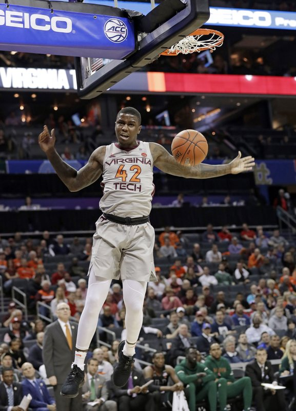Virginia Tech's Ty Outlaw (42) reacts after a dunk against Miami during the first half of an NCAA college basketball game in the Atlantic Coast Conference tournament in Charlotte, N. (AP Photo/Chuck Burton)