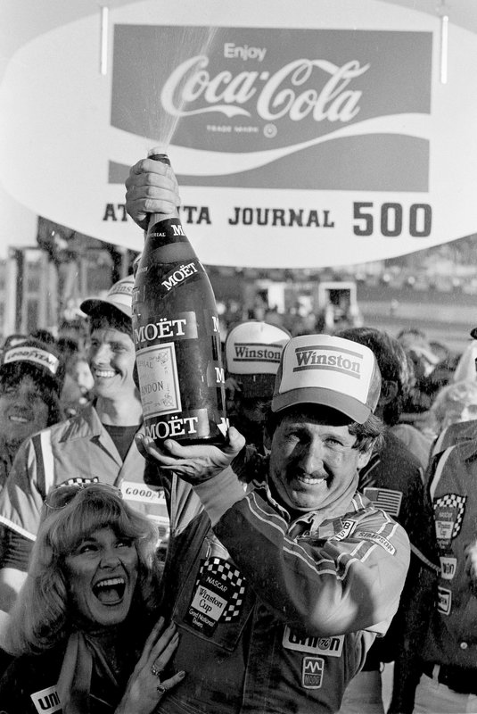 FILE - In this Nov. 8, 1981, file photo, driver Neil Bonnett, of Hueytown, Ala., sprays champagne in Victory Lane after winning the Atlanta Journal 500 auto race at Atlanta International Raceway in Hampton, Ga. (AP Photo/Gary Gardiner, File)